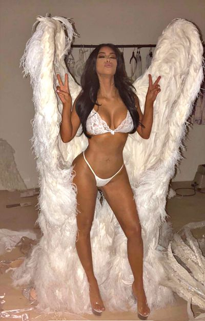 Kim Kardashian stuns in her white lingerie and magnificent arch angel wings.