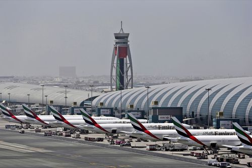 FILE - In this April 20, 2017 file photo, Emirates planes are parked at the Dubai International Airport in Dubai, United Arab Emirates. Major disruptions due to the new coronavirus have already caused the equivalent of a roughly $100 million loss to airline carriers in the Middle East region, which serves as a connection hub for east-west travel, the industry's main trade association said on Monday, March 2, 2020. (AP Photo/Kamran Jebreili, File)