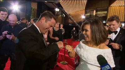 TODAY presenters Karl Stefanovic and Lisa Wilkinson fist bump.