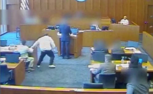 """In the footage, Siale Angilau is seen grabbing his lawyer's pen as people cry out """"whoa, whoa, whoa!"""" (Supplied)"""