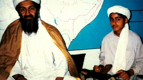 Osama bin Laden, now dead, sits with his young son Hamza, date unknown. (60 Minutes)