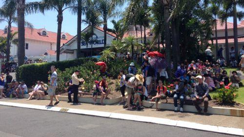 Crowds wait outside Sea World after the park evacuation. (9NEWS / Brittney Kleyn)
