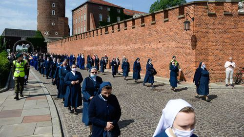Nuns practice social distancing during an outdoor mass in Krakow, Poland.