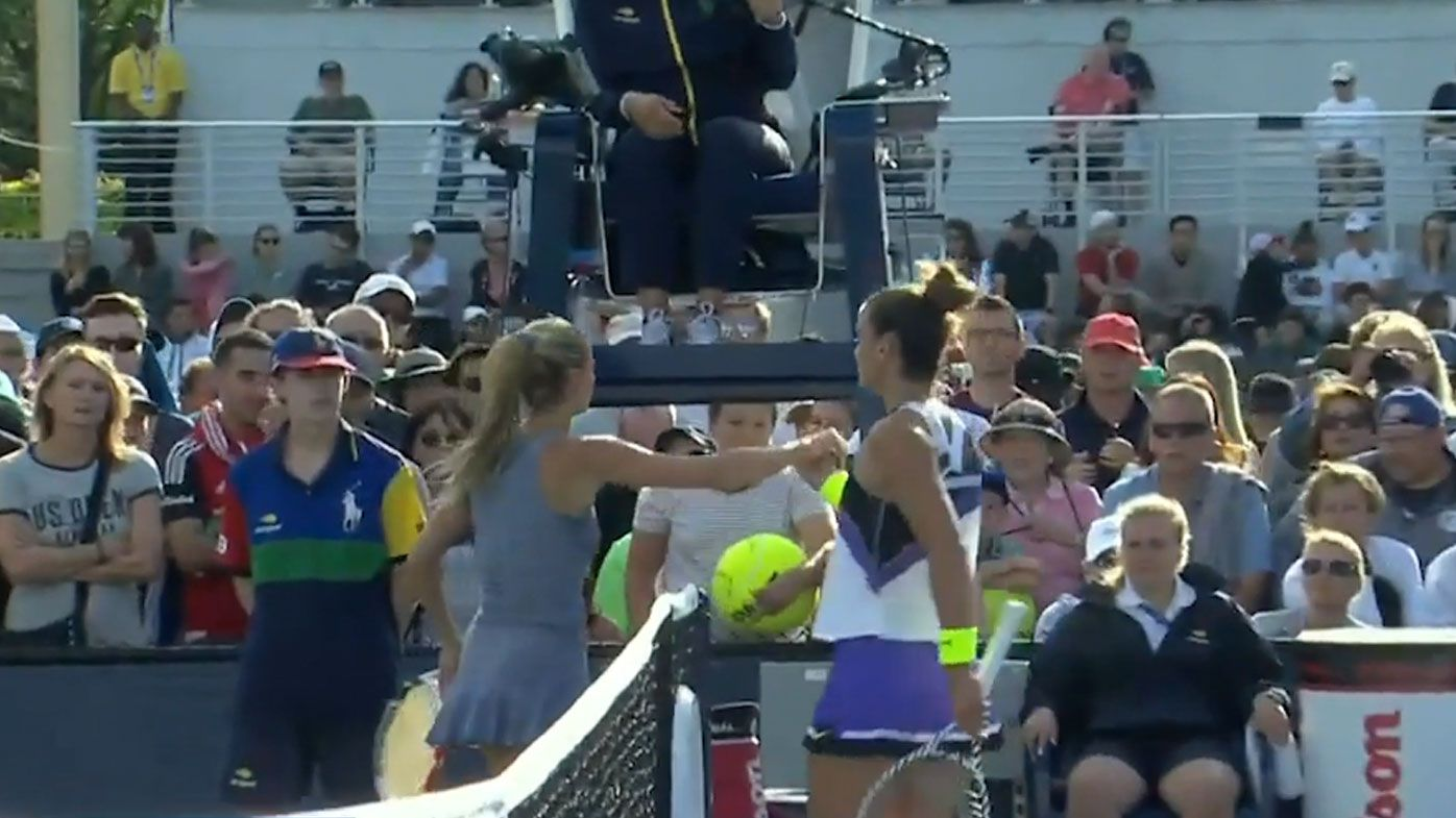 Maria Sakkari and Camilla Giorgi meet at the net after her win