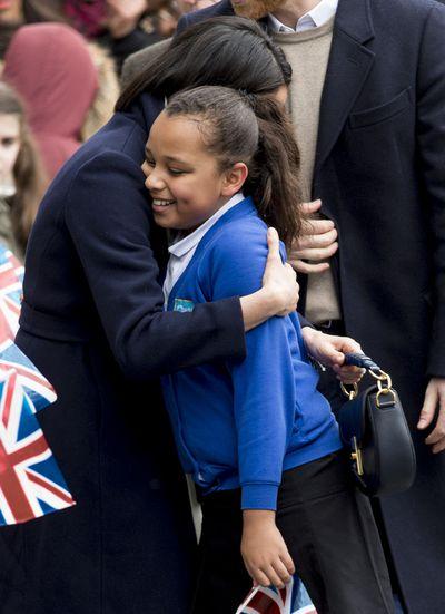 Meghan embraces a fan in Birmingham, England