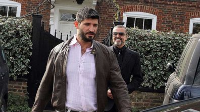 George Michael and Fadi Fawaz are seen leaving the London abode in 2012.