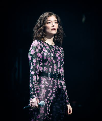 Lorde in a custom belted-jumpsuit at Glastonbury, June.