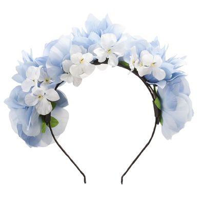 """<a href=""""https://www.lovisa.com.au/blue-flower-crown"""" target=""""_blank"""">Lovisa Blue Flower Crown, $29.99.</a>"""