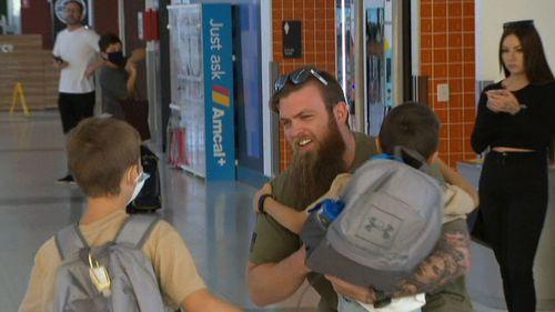 Families reunited at Perth Airport as WA border reopens