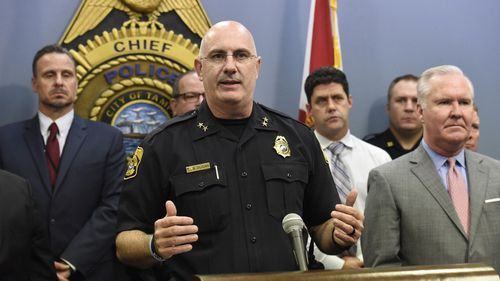 Tampa Police Chief Brian Dugan, center, along with Mayor Bob Buckhorn, right, announce that they intend to charge Howell Emanuel Donaldson, 24, with four counts of first degree murder in connection with the Seminole Heights homicides (Chris Urso/Tampa Bay Times via AP)