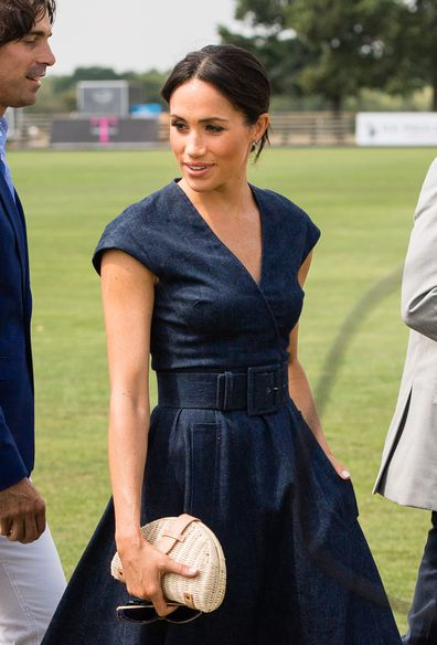 788730d446 Meghan Markle wears perfect Carolina Herrera denim dress to polo ...