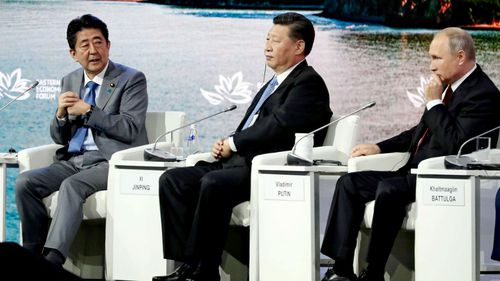 From left:  Japan's Prime Minister Shinzo Abe, China's President Xi Jinping and Russia's President Vladimir Putin at the economic conference.