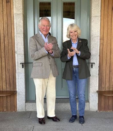 Prince Charles and the Duchess of Cornwall, joining in 'Clapping for our Carers' outside the front door of their home at Birkhall in Balmoral, Scotland