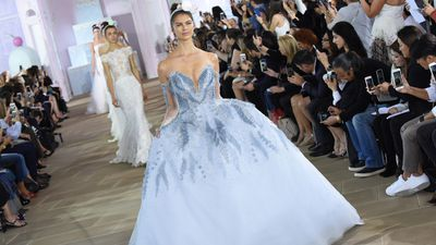 "Most romantically-inclined potential brides dream of a white wedding but designers at <a href=""http://honey.nine.com.au/2016/10/07/11/30/bridal-fashion-week-wedding-dress-new-york"" target=""_blank"">New York Bridal Fashion Week</a> are getting more colourful with their creations. <br /> The majority of dresses are white meringues, mermaid gowns or slinky '20s numbers but sneaking down the aisle are colourful gowns to offer an emotive alternative to people who feel uncomfortable with white's pure connotations. <br /> One of Australia's leading celebrity stylists Ken Thompson, who has worked with Kylie Minogue, Eva Longoria and Shannen Doherty, is all for making that something blue on the big day your dress.<br /> ""It's a celebration,"" Thompson says. ""Embrace colour, especially for a summer wedding. What could be more joyous busting out of the monochrome mode.<br /> ""Sparky citrus hues will give a Pantone paradise without screaming school formal. Plains are a must though.""<br /> Thompson's advice extends to the bridal party. ""Make sure that the whole group is tonal. It's also a great excuse for a groom to bust out of a penguin suit and enjoy the day in an unstructured cream linen suit."""