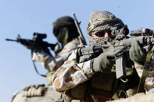 Australian SAS Soldiers on patrol near Bagram, Afghanistan.