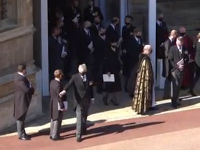 Man waves to car outside St George's Chapel after Prince Philip's funeral