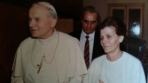 The mother of Emanuela Orlandi with Pope John Paul II.