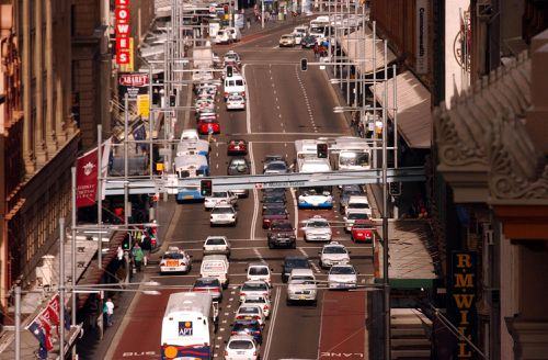 Notorious for its traffic snarls, George St in Sydney will soon only get busier with a tram running through the middle of the road. Picture: AAP