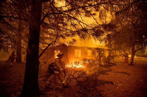More than 5500 fire personnel were battling the blaze that covered 590 square kilometres and was halfway contained, officials said.