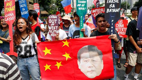 Protesters rally against Xi Jinping in the Philippines.