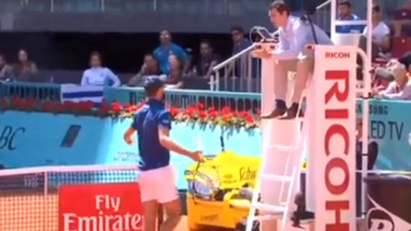 Spitting tennis star loses it over umpire's decision