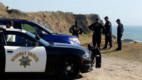 California Highway Patrol officers and deputy sheriffs from Mendocino and Alameda counties gather after a search for the three missing children. (AP)