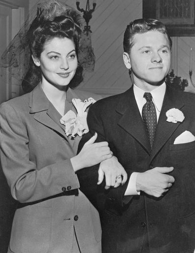 Mickey Rooney Ava Gardner pose for camermen after marriage ceremony at the Santa Ynez Valley Presbyterian Church.