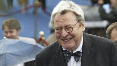 Film director Alan Parker arrives at the opening ceremony of 26th Moscow International Film Festival in Moscow on June 18, 2004