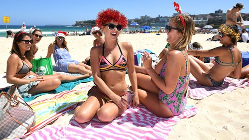 Revellers spending Christmas Day at Sydney's Bondi Beach next year. (AAP)