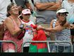 Tennis fans fight over souvenir