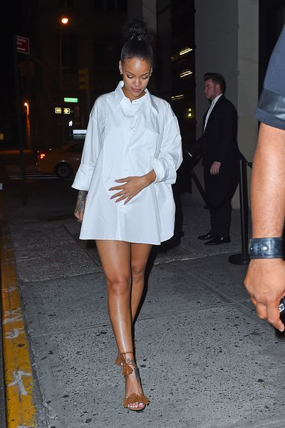 Tailored shirting is perfect for a more formal approach. Rihanna's simple sandals are a relaxed addition.