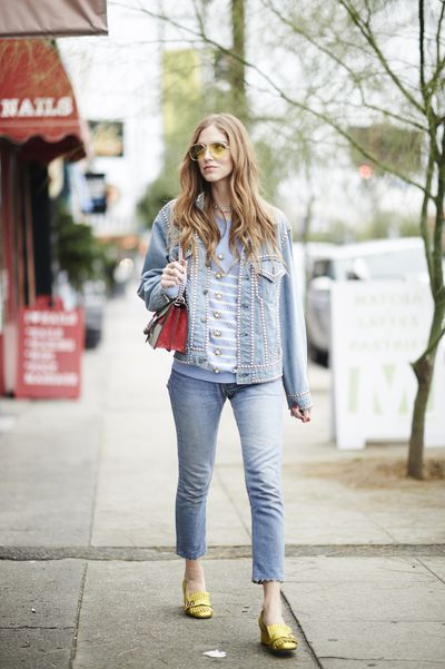Blogger Chiara Ferragni matches her Gucci loafers, bag and sweater with double denim for a vintage, '90s-inspired look.