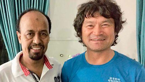 Pakistan Alpine Club secretary Karrar Haidri, left, is pictured with missing Korean climber Kim Hong Bin.