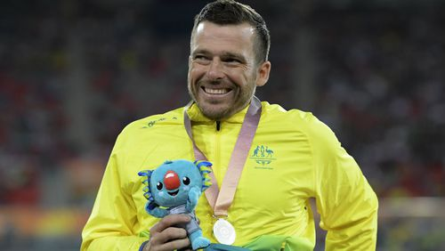 The 37-year-old with his silver medal from the men's T54 1500m. (AAP)