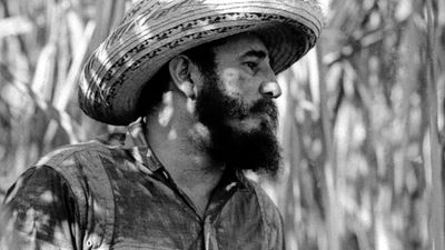 In this April 14, 1966  photo, Cuba's leader Fidel Castro stands on a sugar cane plantation in Cuba. (AAP)