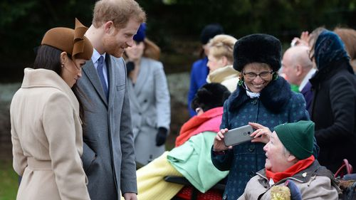 Prince Harry and Meghan Markle meet people outside St Mary Magdalene Church . (PA Wire)