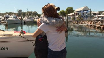 Three yachtsmen have been reuinted with their families after being stranded at sea.