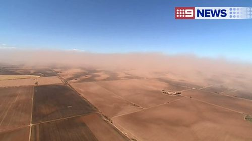 Motorists urged to take extreme care as large dust storm sweeps area north of Adelaide