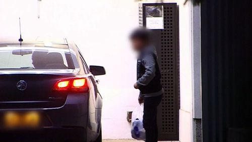 The child arrives at Grafton police station to be reunited with his family. Picture: 9NEWS