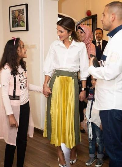 <p>Queen Rania of Jordan, in a shirt by Maison and skirt from Sacai, in Amman, September, 2018</p>