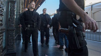 Police officers walk Hollywood Boulevard near El Capitan Theatre before the start of the premiere. (Getty)