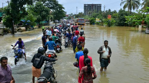 The state's top elected official, Pinarayi Vijayan, told reporters that at least 324 people had died and more than 220,000 had taken refuge in the camps.