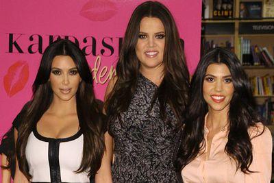 Kim, Khloe, and Kourtney Kardashian in 2010, signing their book <i>Kardashian Konfidential</i>.<br/>