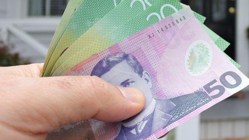The New Zealand dollar plummeted after a surprise half-per cent interest rate cut.