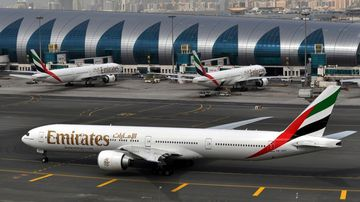 An Emirates plane taxis to a gate at Dubai International Airport at Dubai International Airport in Dubai, United Arab Emirates. (AP)