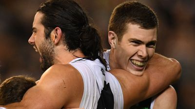 American Mason Cox cheered as Collingwood trumps Richmond
