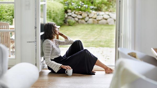 Woman sitting in doorway.