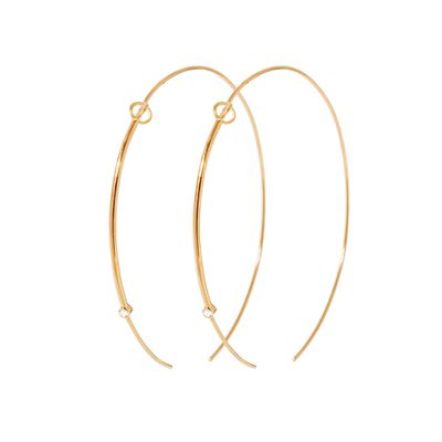 "<a href=""https://www.sarahandsebastian.com/collections/women/products/foam-hoop-gold"" target=""_blank"">Hoops, $1600, Sarah and Sebastian</a>"