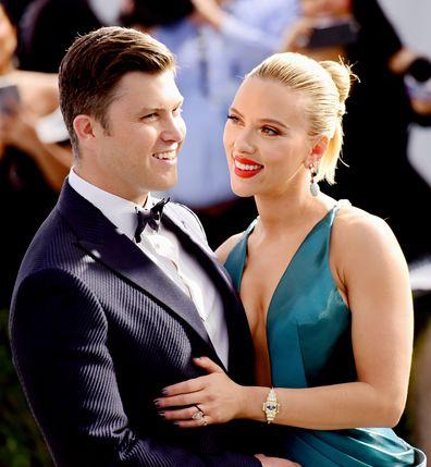 Colin Jost (L) and Scarlett Johansson