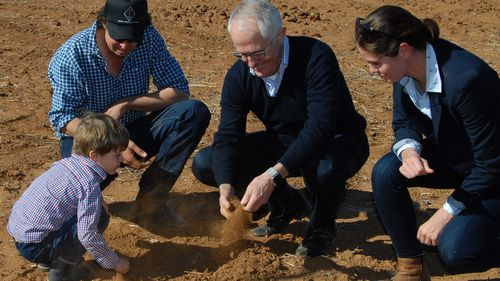 Australian Prime Minister Malcolm Turnbull is seen with farmer Phillip Miles, his wife Ashley and their son Jack during a visit to Trangie, NSW last month. (Photo: AAP)